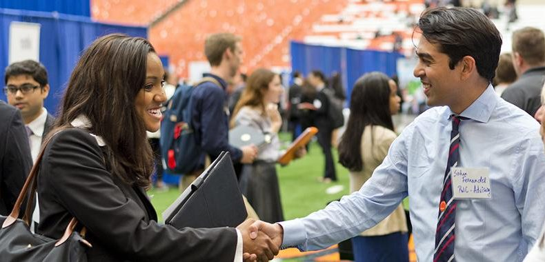 Student shaking hands with an employer at the career fair.