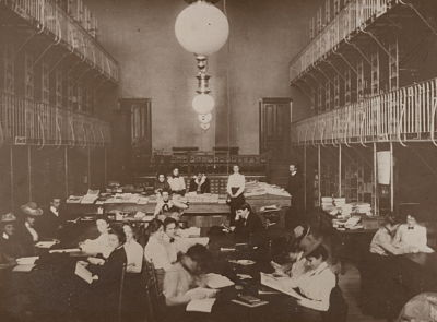 old black and white photo of students studying at tables in van Ranke Library