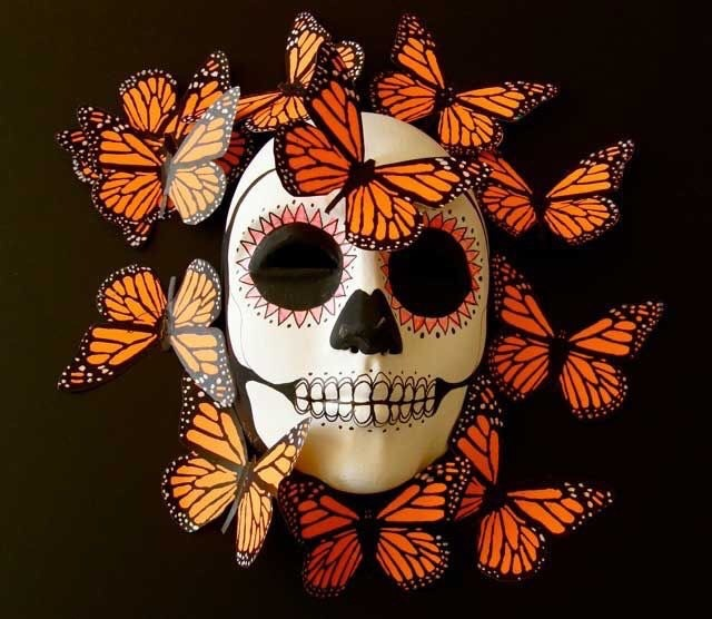 Day of the Dead skeleton head surrounded by butterflies