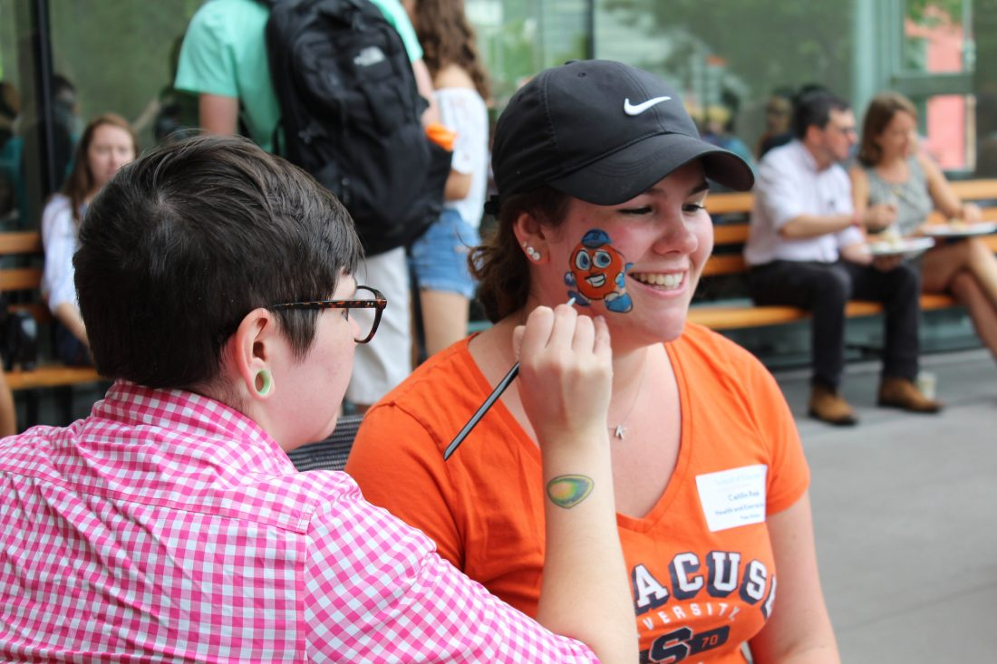 A student gets Otto painted on her face during a welcome back picnic