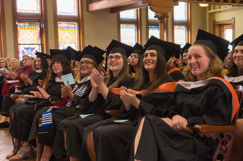Students seated during convocation ceremony.