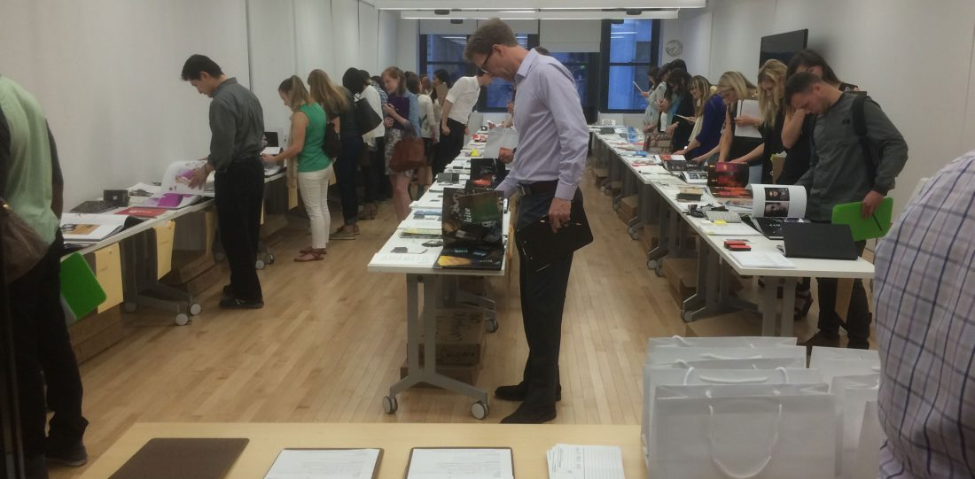 Prospective employers review communication design students work in NYC.
