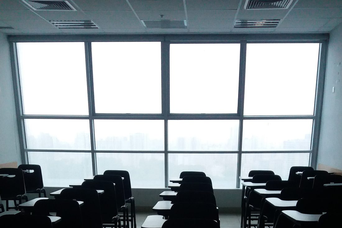 Photo of an empty classroom showing windows and HVAC in the ceiling