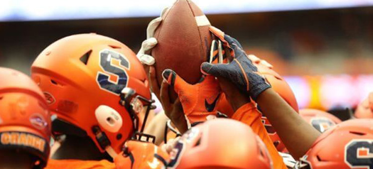 Syracuse University Helmets with Football Raised in the air
