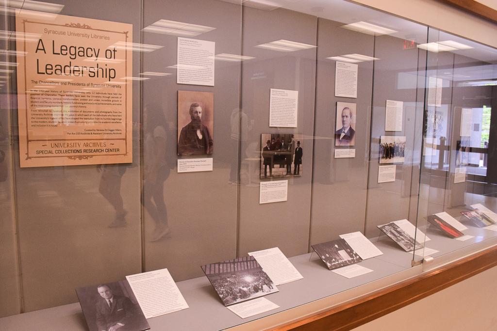 display case of Chancellor's exhibit with photos of each chancellor and descriptive text to accompany