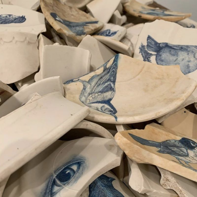ceramic shards with blue sketches of birds