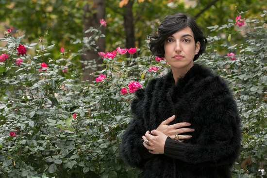 Elif Batuman in field of flowers