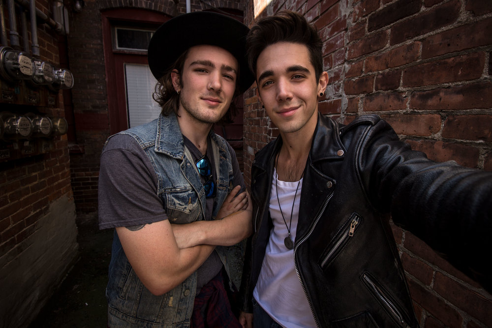 Ende Brothers pose together in an alleyway