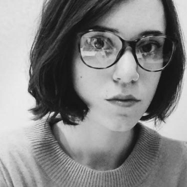 A black-and-white profile picture of Professor Erin Pineda