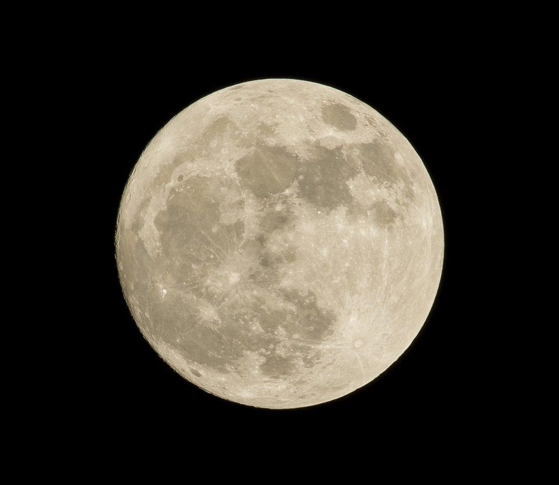 A full moon against a black sky.