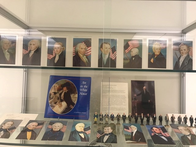 shelves in display case featuring Presidents Washington to Gran
