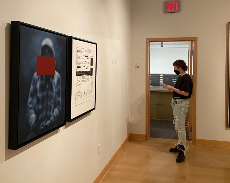 Woman in a museum looking at artwork