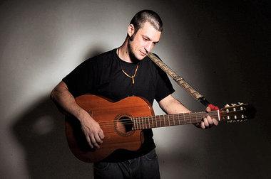 Joe Driscoll holding guitar