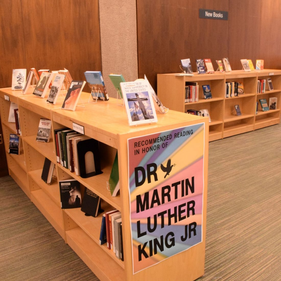 new book shelf area with books and poster on shelf that reads: Recommended Reading in Honor of Dr. Martin Luther King Jr.
