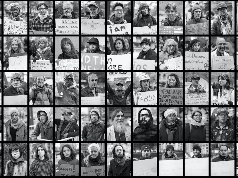 Square grid made up of numerous black-and-white individual portraits