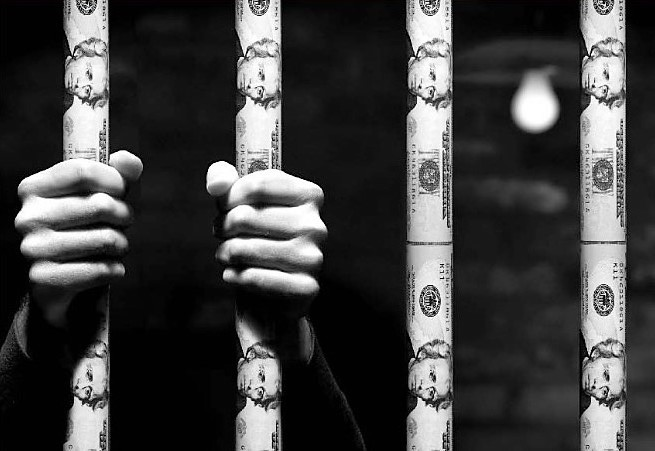Hands clutching prison bars wrapped in dollar bills