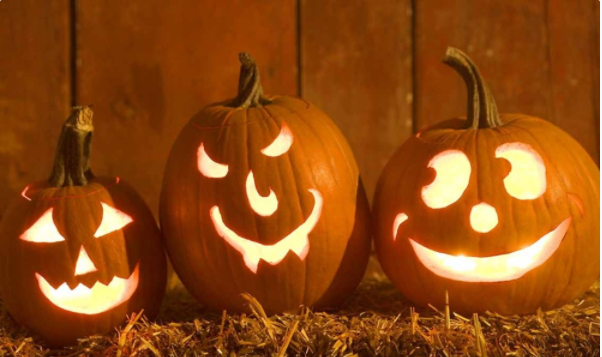 Three jack-o-lanterns. One with a happy face, one with a devious face and one with a goofy smile.