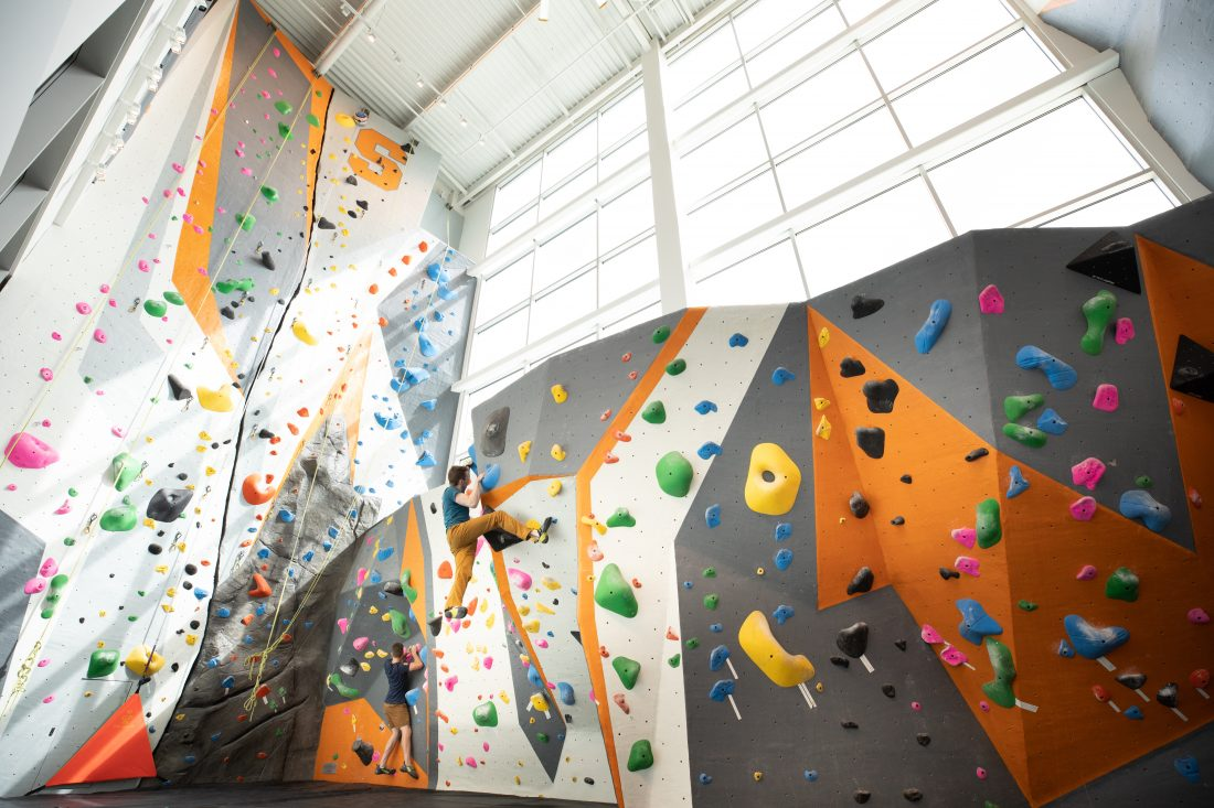 Two-story rock climbing wall and bouldering area in the Barnes Center