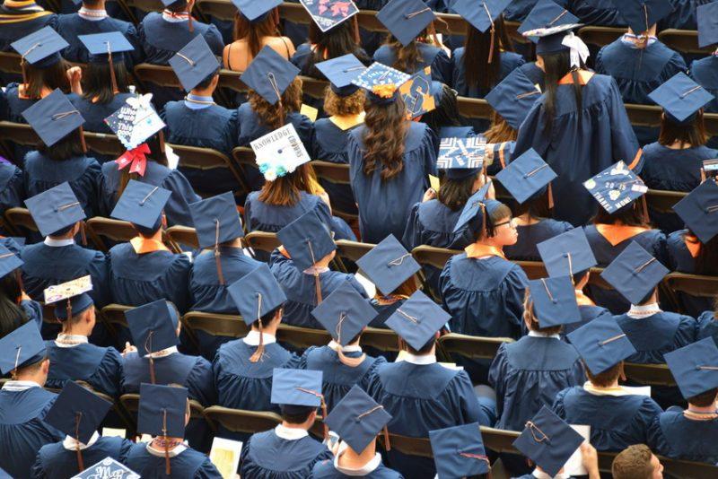 graduation caps in a crowd