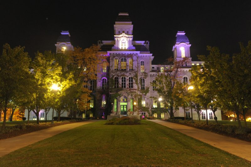 The Hall of Languages illuminated in purple for Domestic and Dating Violence Awareness Month.