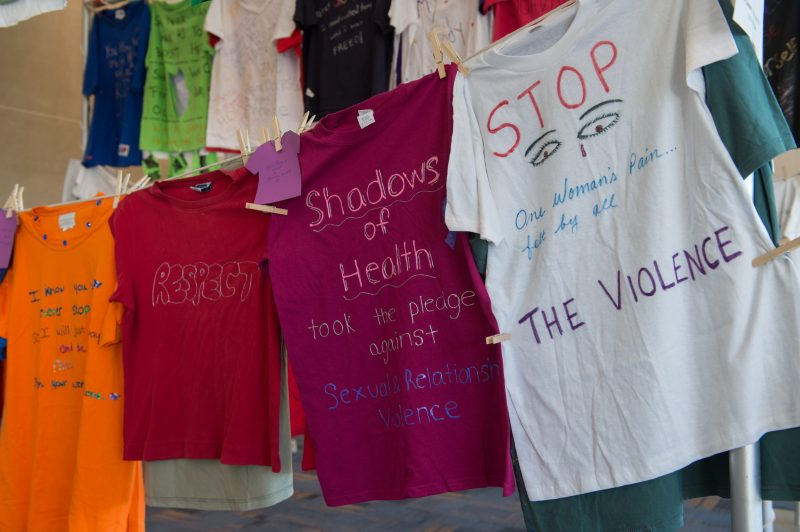 T shirts decorated by people impacted by interpersonal violence displayed in the Clothesline Project.