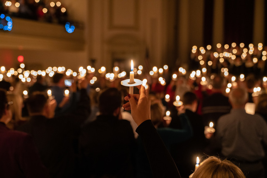 People holding candles in Hendricks Chapel