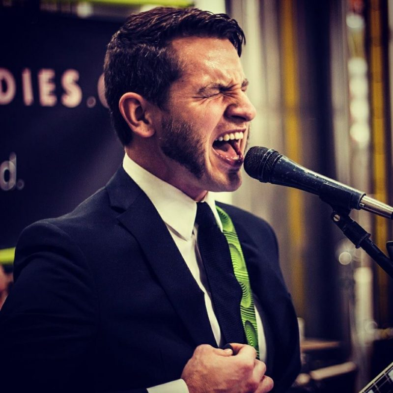 Musician Sam Swanson at microphone singing