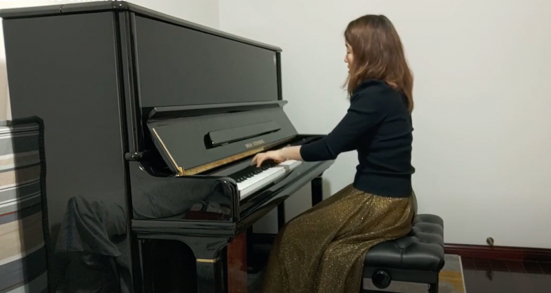 A student plays the piano.