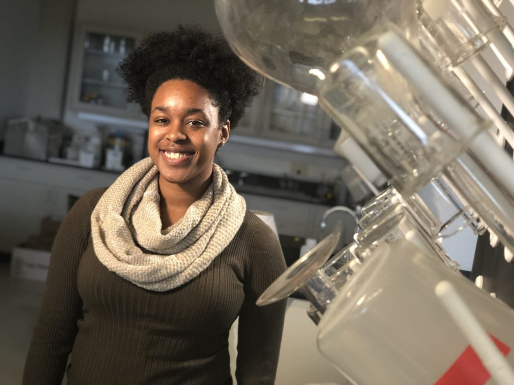 photo of Alumna Simone Burns, Environmental Engineering 2019, in her lab