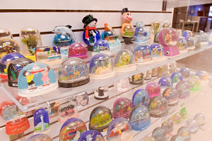 shelves of various plastic colorful snow domes