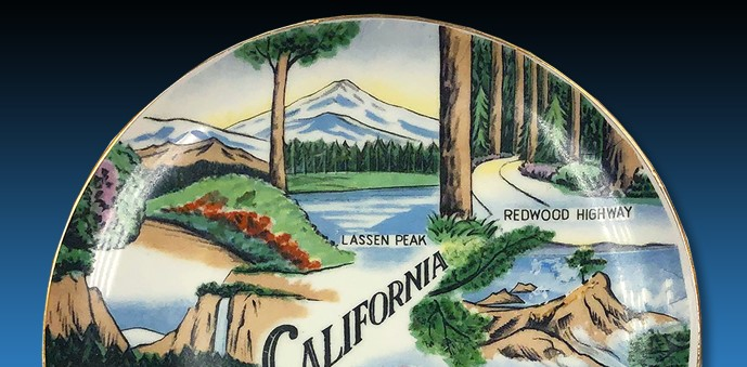 plate with pictures of California icons, including Lassen Peak and Redwood Highway