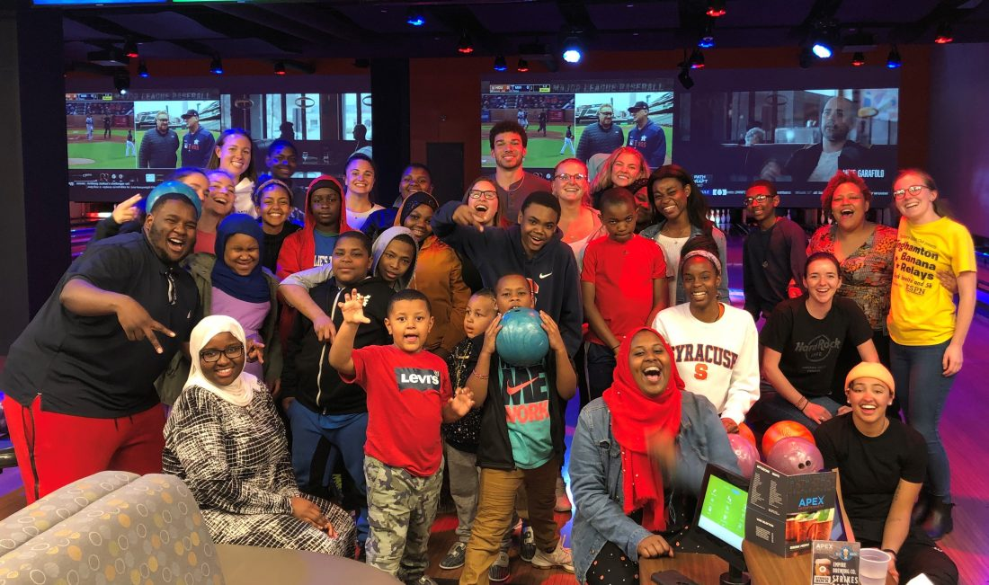 Syracuse University students and local youth at Apex Entertainment