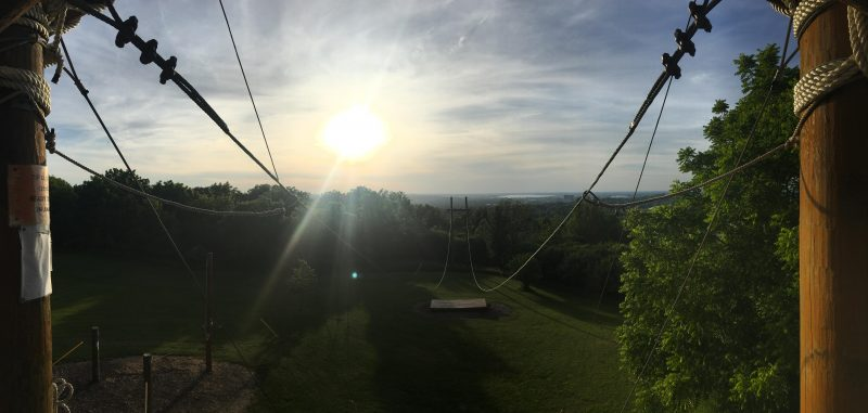 A view of the Syracuse skyline at dusk from the south campus challenge course.