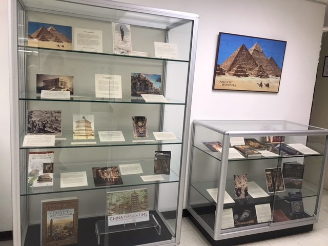 display case holding books and images