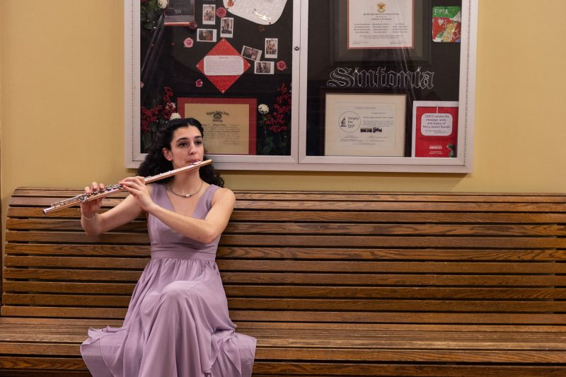 A student practices the flute.