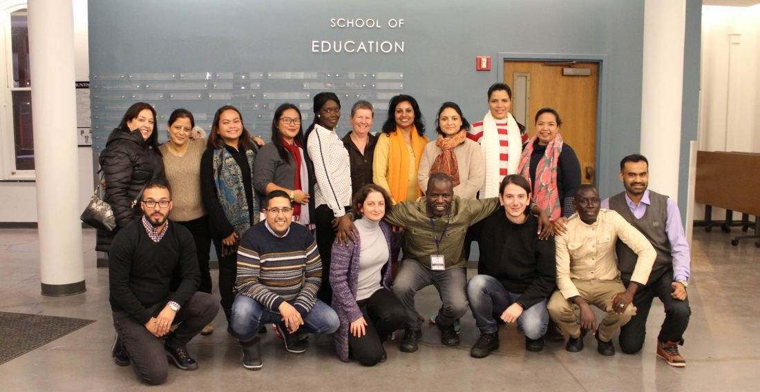 Fulbright students posing in the School of Education
