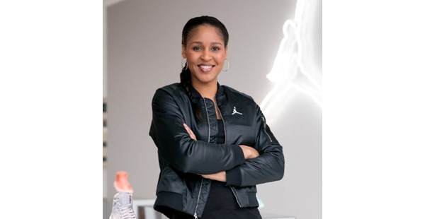 Portrait of Maya Moore standing with her arms crossed and smiling