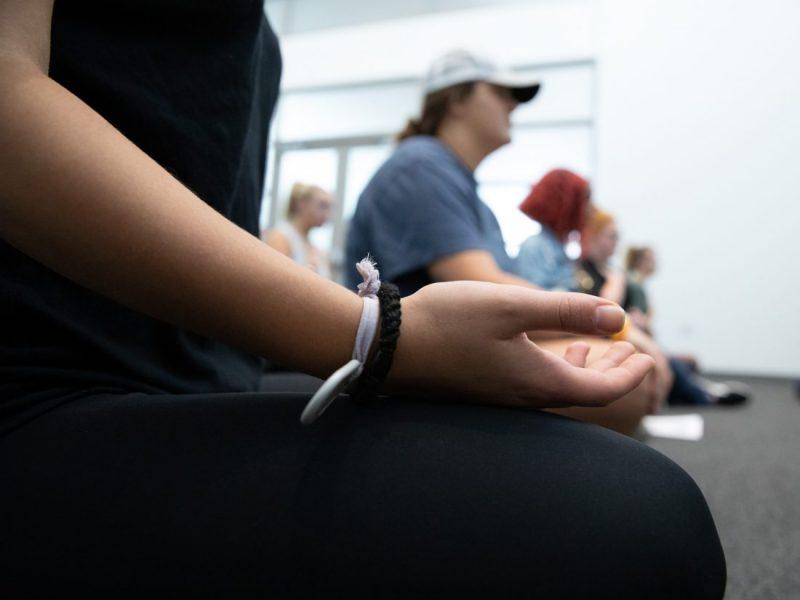 Line of people meditating