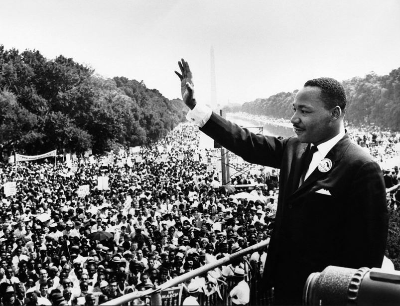 Rev. Dr. Martin Luther King Jr. in front of a crowd