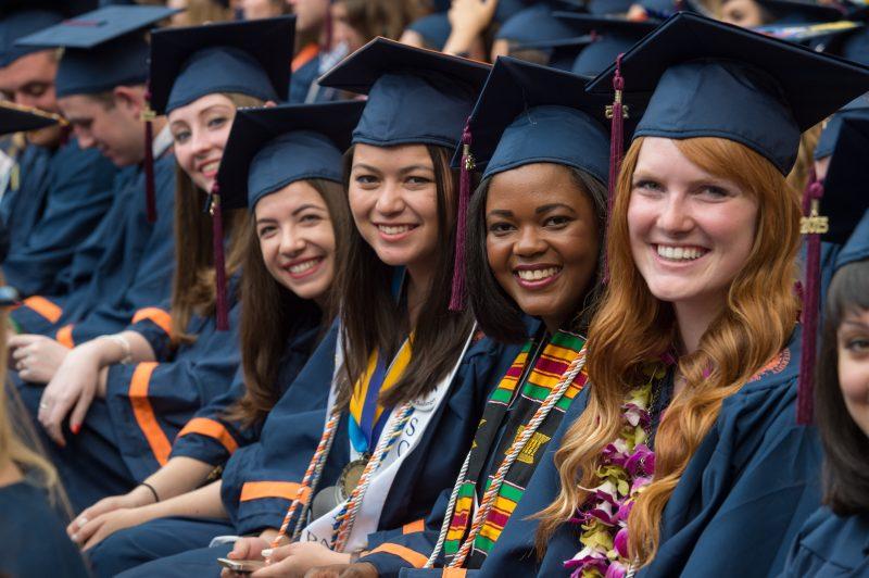 Seated graduating students.
