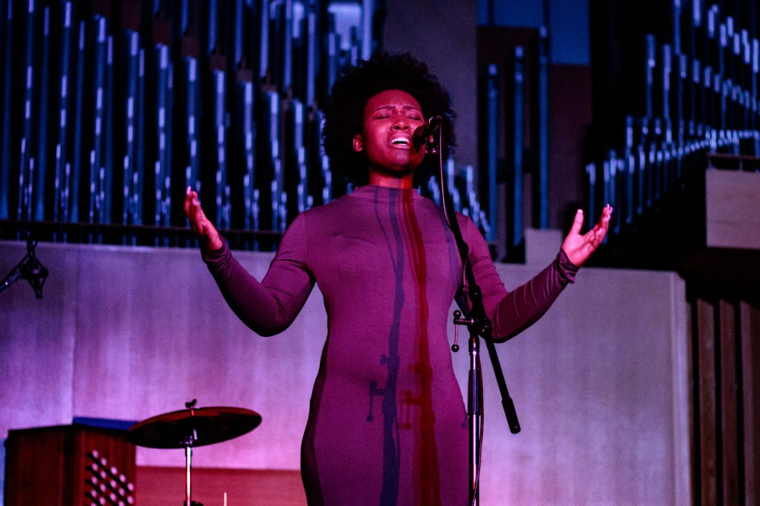 A student performs onstage during a Prism Concert.