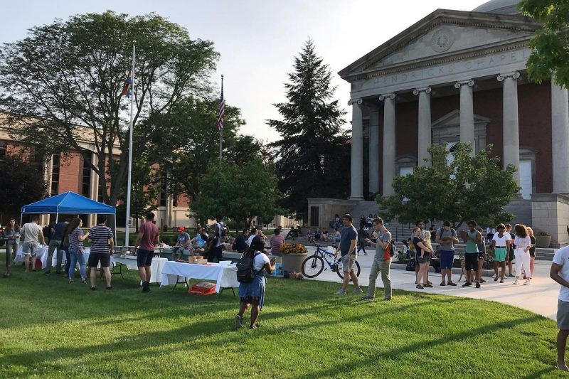 Students gathered in front of Hendricks Chapel for a picnic