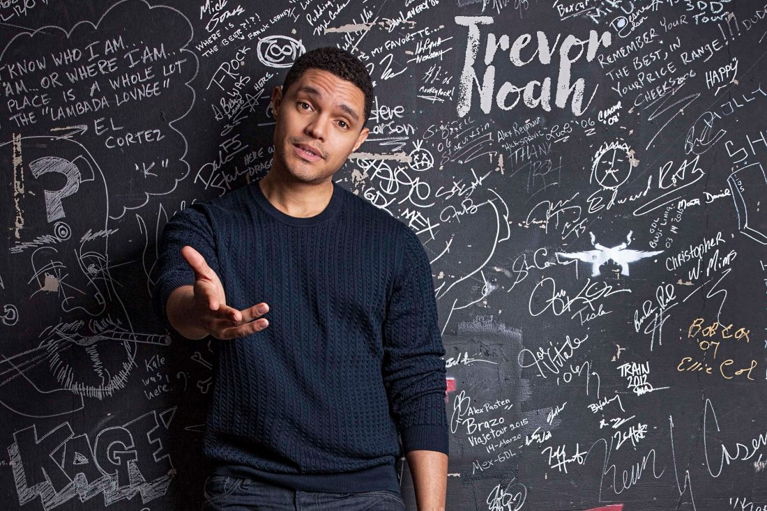 Trevor Noah in front of chalkboard