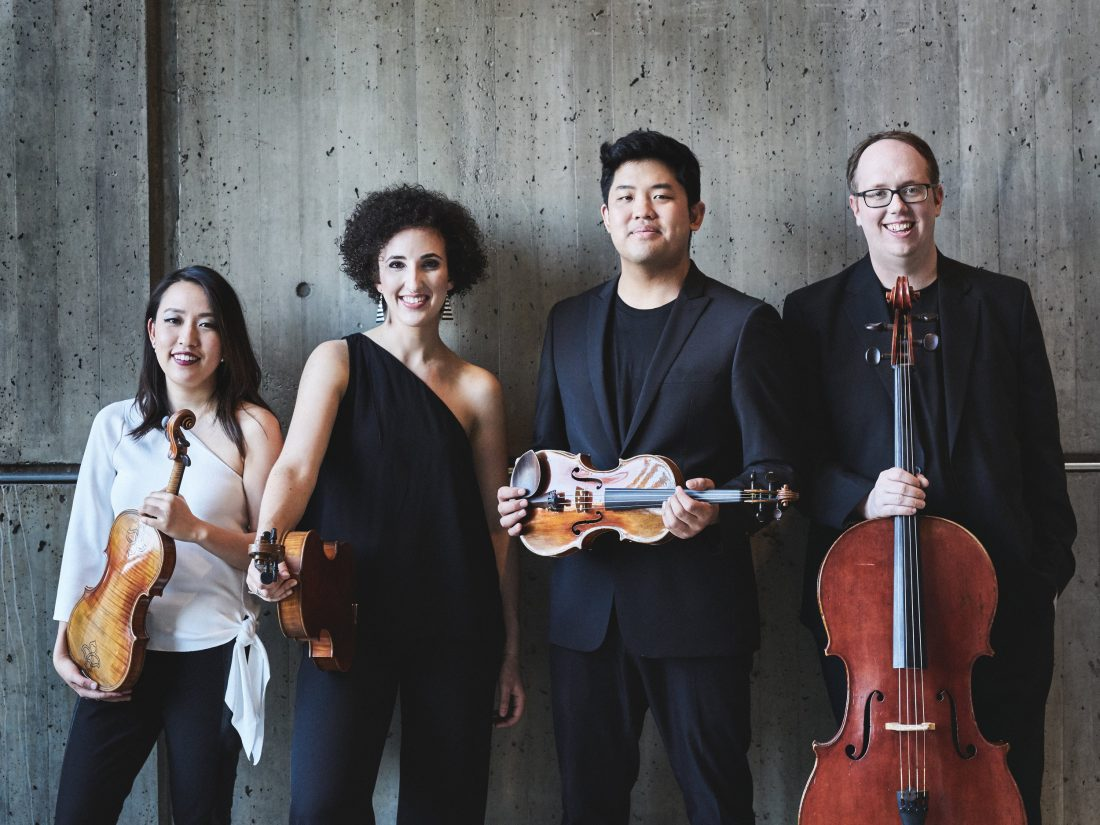 The 4 members of the Verona Quartet with their instruments